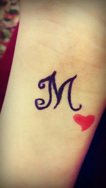رسم حنه على اليد حرف M